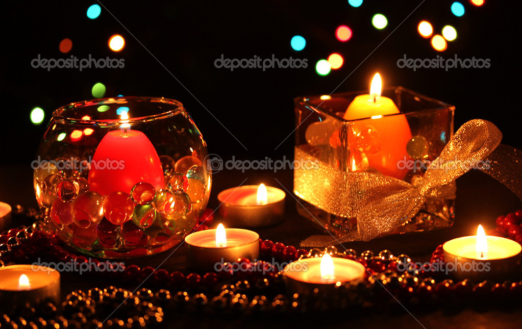 Wonderful composition of candles on wooden table on bright background — Stock Photo #9373438