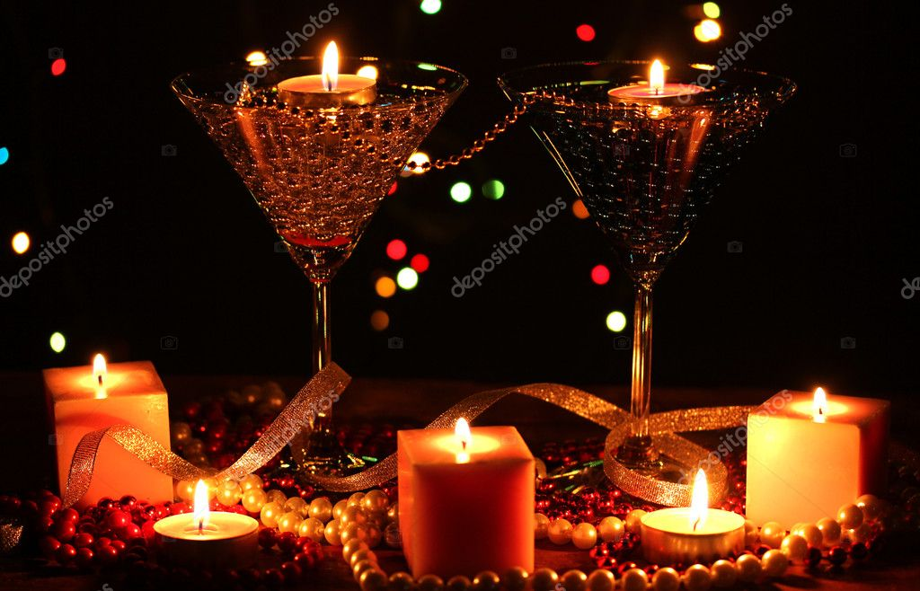 Amazing composition of candles and glasses on wooden table on bright background — Stock Photo #9378182
