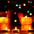 Wonderful candles on wooden table on bright background — ストック写真