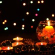 Wonderful composition of candles on wooden table on bright background - Stock fotografie