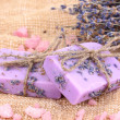 Hand-made lavender soaps on sackcloth - Stock Photo
