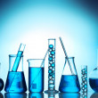 Test-tubes with blue liquid on blue background — Stock Photo #9396693
