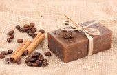 Hand-made soap on sackcloth — Stock Photo
