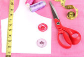 Scissors, threads, buttons, measuring tape and pattern on fabric close-up — Stock Photo