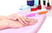 Beautiful women hands on pink towel — Stock Photo