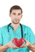 Young doctor man with stethoscope and heart on blue backgrounds — Stock Photo