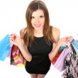 Stock Photo: Beautiful young woman with shopping bags isolated on white