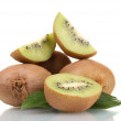 Juicy kiwi fruits with leaves isolated on white — Stock Photo