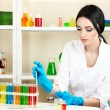 Young female scientist looking in chemistry laboratory — Stock Photo #9418585