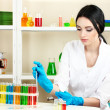 Young female scientist looking in chemistry laboratory — Stock Photo