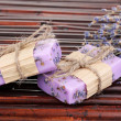 Hand-made lavender soaps on bamboo mat - Stock Photo