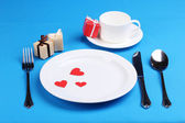 Table setting on blue background — Stock Photo
