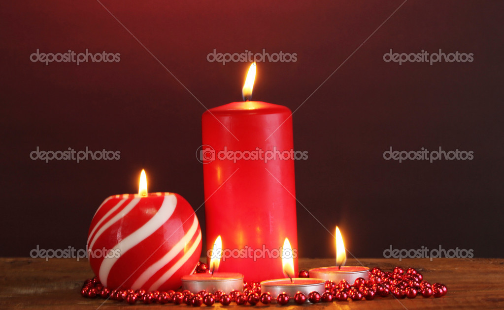 Wonderful candles on wooden table on dark background — Stock Photo #9418583