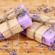 Royalty-Free Stock Photo: Hand-made lavender soaps on wooden mat