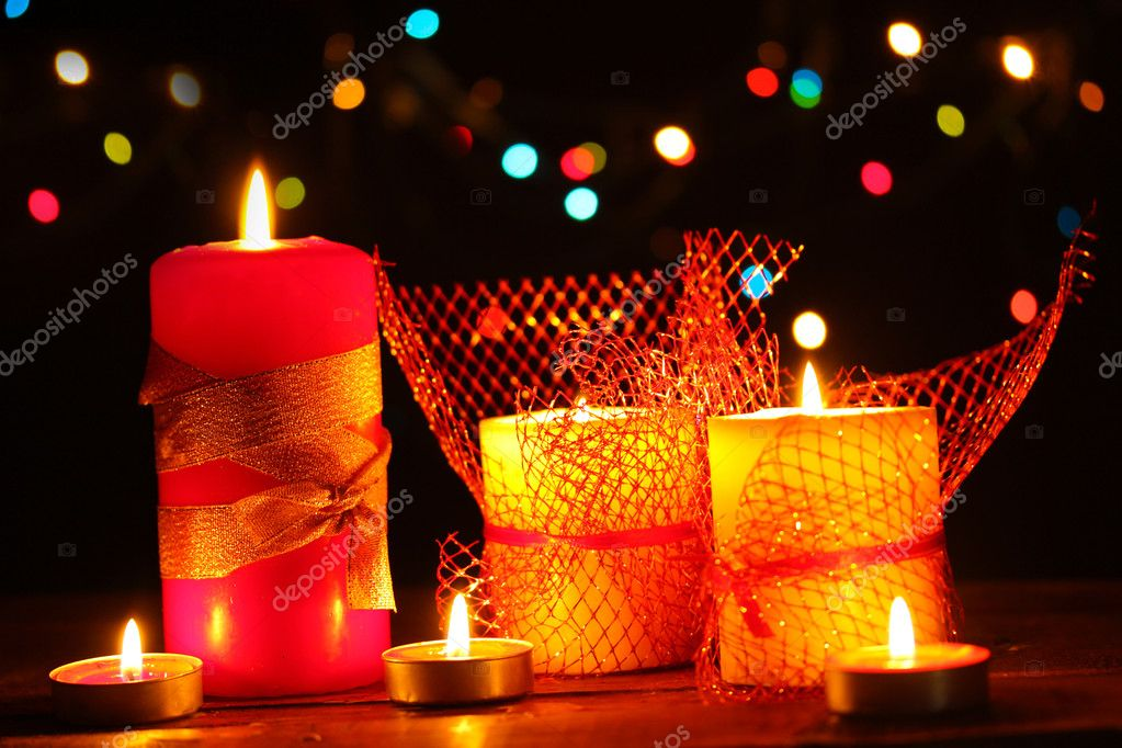 Wonderful candles on wooden table on bright background — Stock Photo #9431000