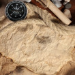Royalty-Free Stock Photo: Old paper, compass and rope on a wooden table