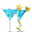 Blue cocktail in martini glasses with ice isolated on white — Stock Photo #9470732