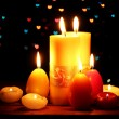 Beautiful candle and decor on wooden table on bright background - Stock Photo