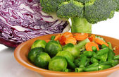 Mixed vegetables on plate close-up isolated on white — Stock Photo