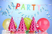 Party items on blue background — Stock Photo