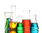 Different laboratory glassware with color liquid and with reflection isolated on white — Stockfoto