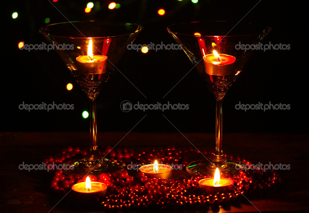 Amazing composition of candles and glasses on wooden table on bright background — Stock Photo #9470824