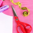 Scissors,threads, measuring tape and pattern on fabric close-up — Stockfoto