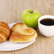 Classical breakfast. Coffee with croissant and bun - Stock Photo