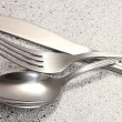 Fork, spoon and knife on marble table - Foto Stock