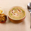 Tasty soup on beige tablecloth - Stockfoto