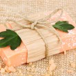 Hand-made natural soap on sackcloth - Stock Photo