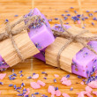 Hand-made lavender soaps on wooden mat — Foto Stock