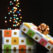 Open gift box with bokeh background on black - Zdjęcie stockowe