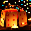 Candles and playing cards on wooden table on bright background — Stock Photo #9538314