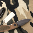Army badges and knife on camouflage background — Stock Photo #9539262