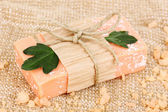 Hand-made natural soap on sackcloth — Stock Photo