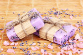 Hand-made lavender soaps on wooden mat — Stock Photo