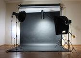 Studio flash on grey background — Stock Photo