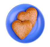 Heart-shaped cookies on saucer isolated on white — Stock Photo