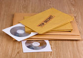 Envelopes with top secret stamp with CD disks on wooden background — Stock Photo