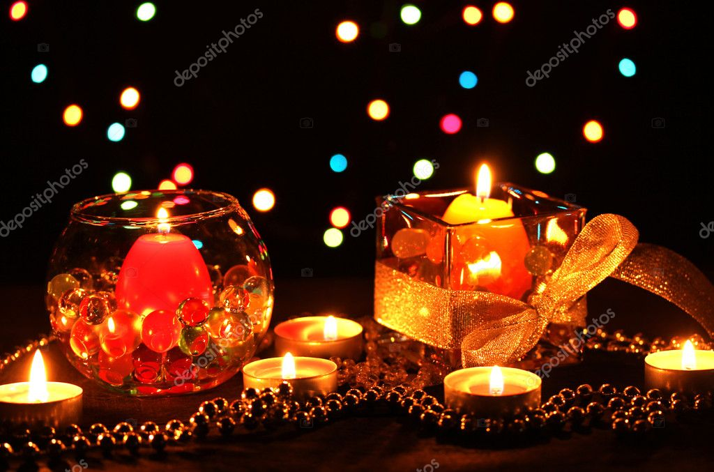 Wonderful composition of candles on wooden table on bright background — Stock Photo #9535263