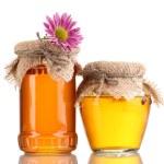 Sweet honey in jars isolated on white — Stock Photo