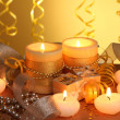 Beautiful candles, gifts and decor on wooden table on yellow background — Stock Photo #9561445