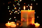 Beautiful candle and decor on wooden table on bright background — Стоковое фото