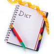 Planning of diet. Notebook measuring tape and pencil isolated on white — Stock Photo
