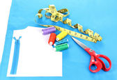 Sewing accessories on fabric isolated on white — Stock Photo