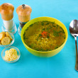 Tasty chicken stock with noodles on blue tablecloth — Stock Photo #9596545