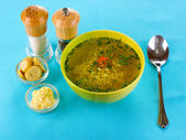 Tasty chicken stock with noodles on blue tablecloth — Foto de Stock