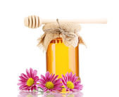 Sweet honey in jar with drizzler isolated on white — Stock Photo