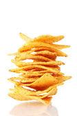 Tasty potato chips isolated on white — Stock Photo